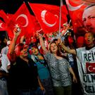 FLAG WAVING: Turks gathered in solidarity to oppose the July 15 coup attempt. The banner on the right reads 'Chief Erdogan I came to die.' Photo: Umit Bektas/Reuters