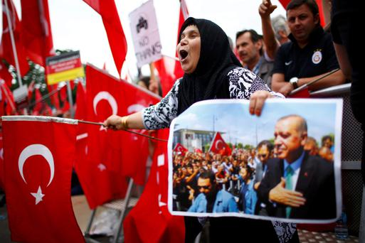 Supporters of President Erdogan wave Turkish flags during a pro-government protest in Cologne, Germany. Photo: Reuters