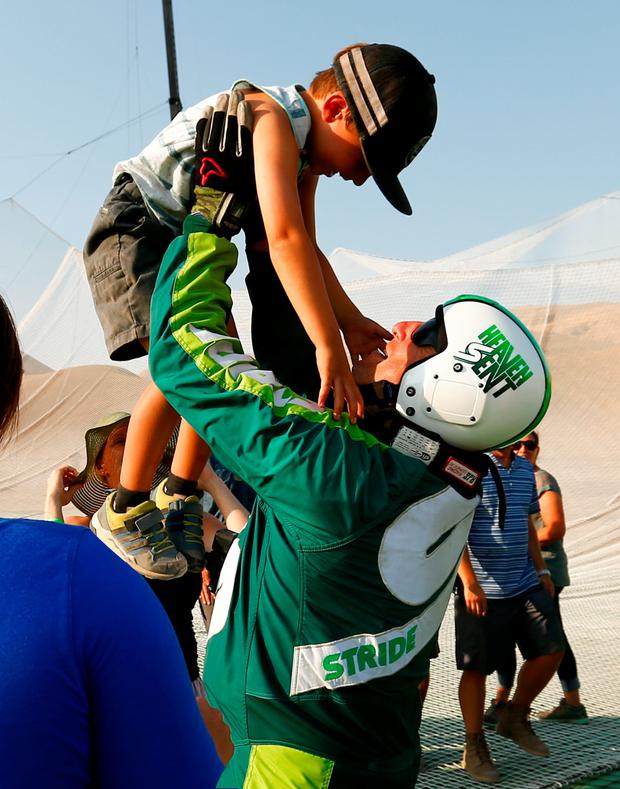 Skydiver Luke Aikins celebrates with son Logan. Photo: Getty