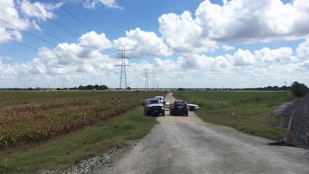 Police cars block the site where the hot air balloon came down on Saturday (AP)