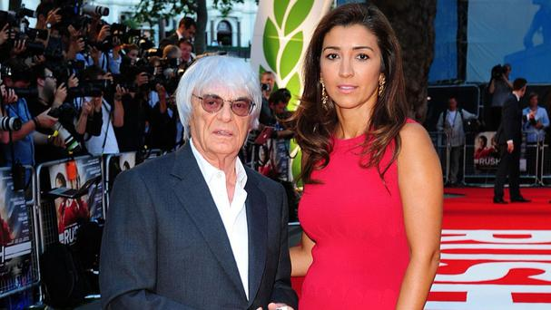 Bernie Ecclestone and his wife Fabiana Flosi, whose mother Aparecida Schunck was freed by police after she was kidnapped in Brazil