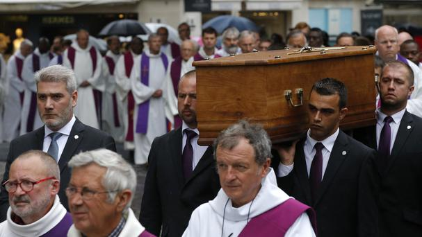 The coffin of Father Hamel is carried outside the Rouen cathedral, Normandy, before his funeral mass (AP)