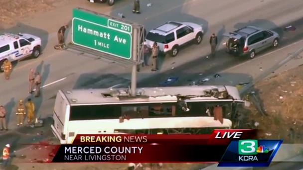 A still frame showing authorities at the scene of a charter bus crash in California (KCRA3-TV via AP)