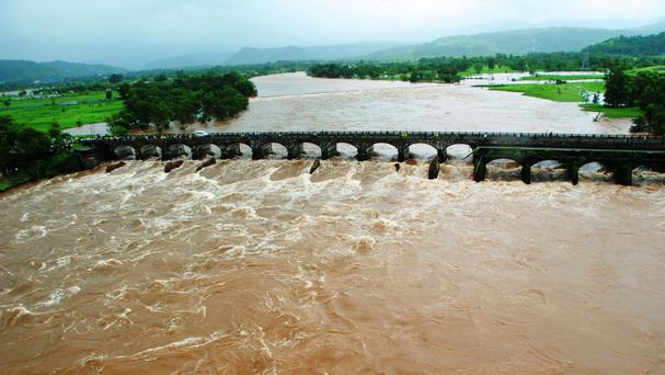A bridge that collapsed in a flooded river in western Maharashtra state, India (Indian Defence via AP)