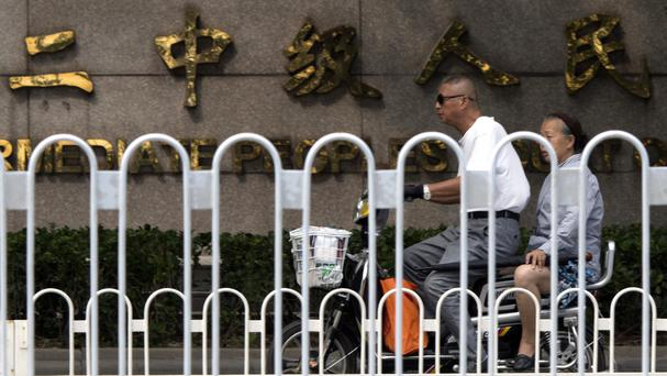 The cases are being heard in Tianjin No 2 Intermediate People's Court (AP)