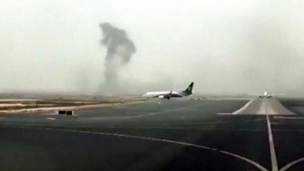 This image made from video shows smoke rising after an Emirates flight crash-landed at Dubai International Airport (Hayen Ayari via AP)