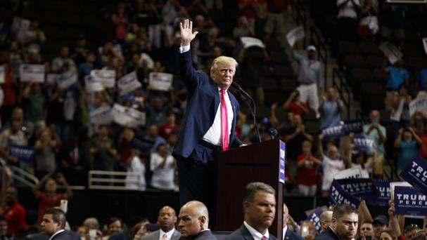 Republican presidential candidate Donald Trump waves after speaking during a campaign rally at Jacksonville Veterans Memorial Arena (AP)