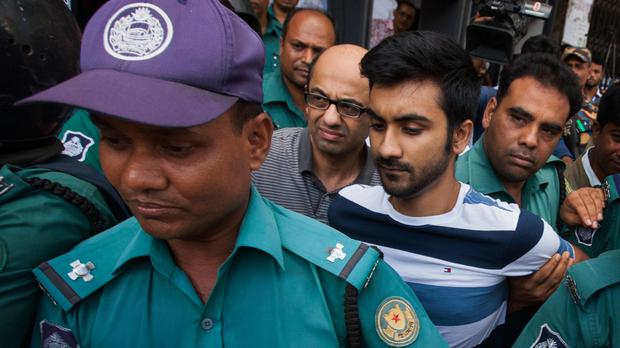 British national Hasnat Karim, centre left, and University of Toronto student Tahmid Hasib Khan, centre right, are taken to court in Dhaka, Bangladesh (AP)