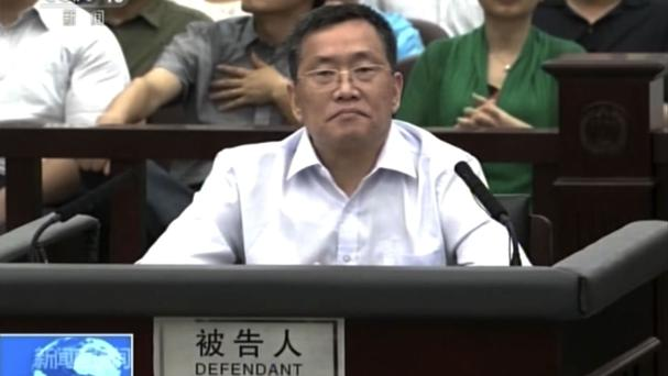 Zhou Shifeng sits for his trial at the Tianjin No 2 Intermediate People's Court in northern China's Tianjin Municipality (CCTV via AP Video)