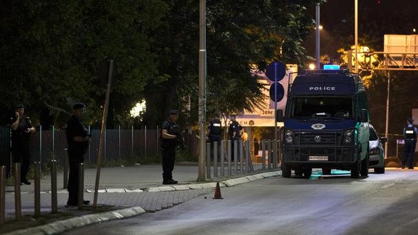 Police officers seal off the area after an explosion hit Kosovo's Parliament (AP)