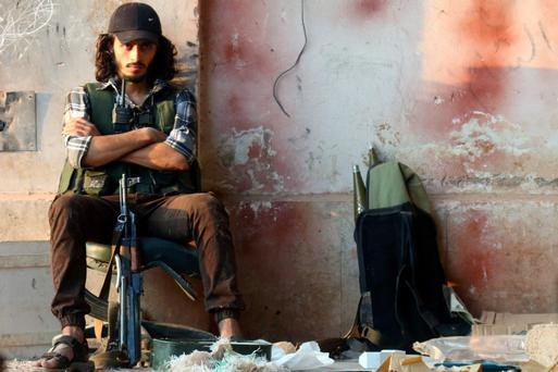 CONFLICT ZONE: A fighter in Aleppo's artillery academy yesterday. Photo: Ammar Abdullah