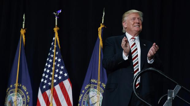 Republican presidential candidate Donald Trump arrives for a campaign rally in New Hampshire (AP)