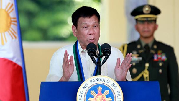 Rodrigo Duterte has stepped up his war against drugs, after a month that has left more than 400 suspects dead (AP)