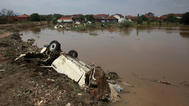 Destroyed vehicles and flooded houses are pictured after an overnight storm, in the village of Singelic, just east of Skopje, Macedonia. (AP)