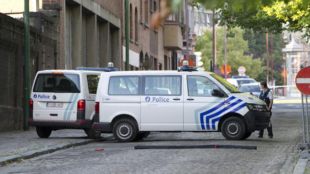 Police officers secure the area near to the police headquarters in Charleroi, Belgium (AP)