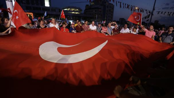The attacks came as Turkey is still reeling from the failed coup last month. Here, supporters of President Recep Tayyip Erdogan stage a rally in Istanbul (AP)
