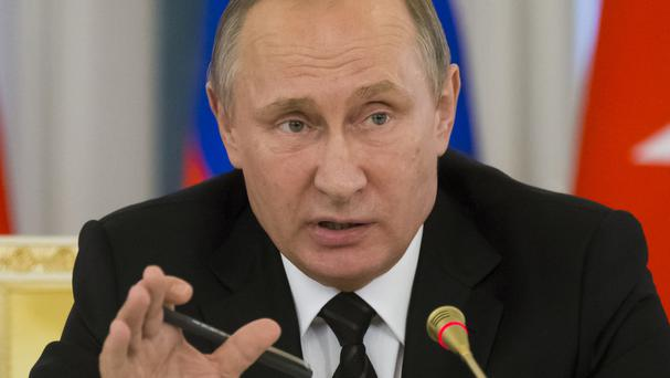 Russian President Vladimir Putin condemned Ukraine over the apparent incursions (AP)