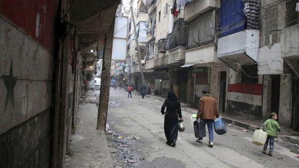 The attack happened in an opposition-held district in the city of Aleppo (Alexander Kots/Komsomolskaya Pravda/AP)