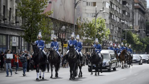 Romanian gendarmes on horseback lead the hearse carrying the coffin of Anne of Romania (AP)