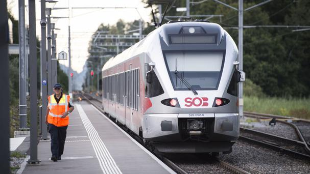 The train stands at the station after a man attacked other passengers aboard the train at Salez, Switzerland (AP)