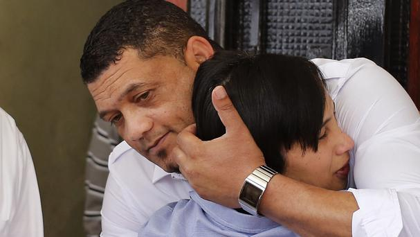 Morne and Celeste Nurse, the biological parents of kidnapped child Zephany Nurse, embrace each other after court proceedings in Cape Town, South Africa (AP)