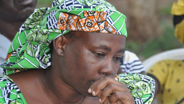 Esther Yakubu, mother of one of the kidnapped schoolgirls, reacts after she saw her daughter in a video (AP)