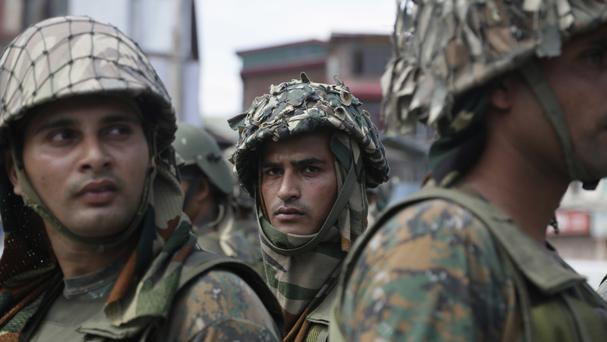 Indian paramilitary soldiers on guard near the site of a gun battle in Srinagar in India-controlled Kashmir (AP)