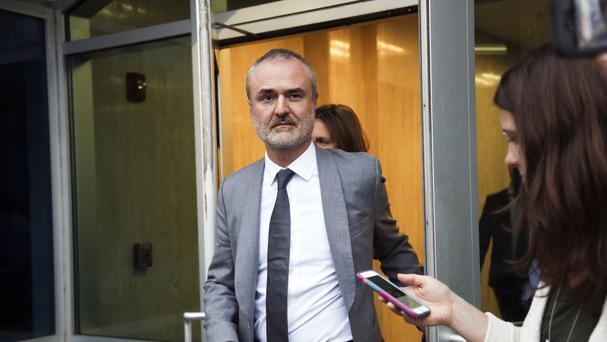 Gawker founder Nick Denton walks out of a court house in Florida (AP)