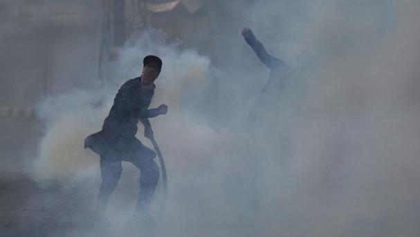 Kashmiri Muslim protesters throw rocks at Indian paramilitary soldiers in Srinagar, Indian-controlled Kashmir (AP)