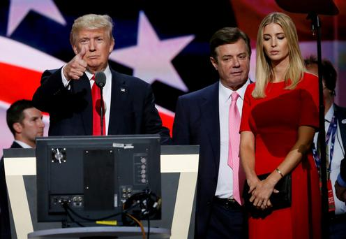 Donald Trump gives a thumbs-up alongside former campaign manager Paul Manafort (centre) and daughter Ivanka at the Republican Convention Photo: Reuters