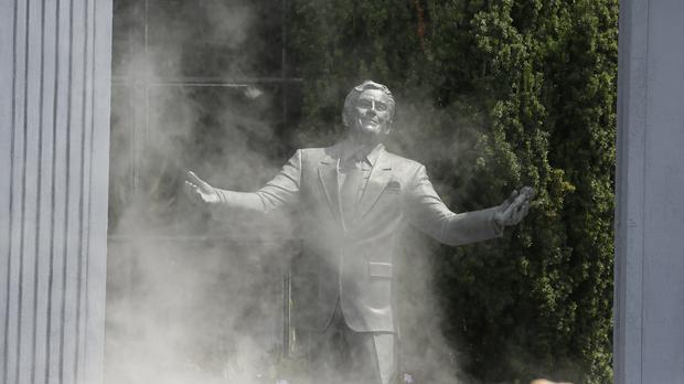 Smoke clears as the statue of Tony Bennett is unveiled (AP)