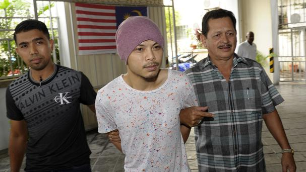Rapper Wee Meng Chee, centre, has been detained in Malaysia (AP)