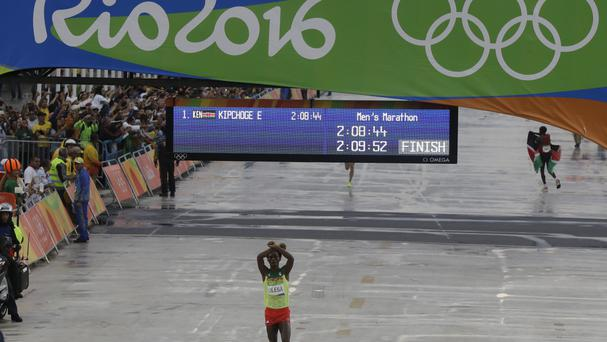 Ethiopia's Feyisa Lilesa crosses his arms as he won silver in the Olympic marathon on Sunday (AP)