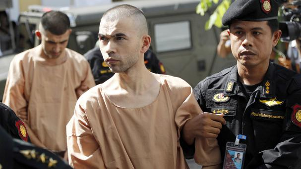 Bilal Mohammad, front, and Mieraili Yusufu are accused of the bombing of a popular shrine in Bangkok (AP)