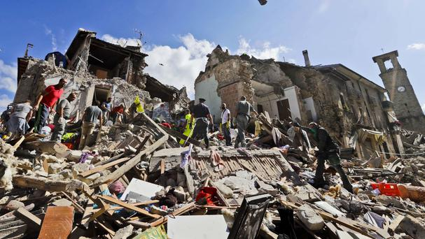 Rescuers search amid rubble following an earthquake in Amatrice, Italy (AP)