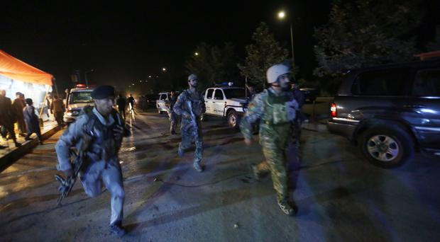 Afghan security forces rush to respond to a complex Taliban attack on the campus of the American University in Kabul. (AP Photo/Rahmat Gul)