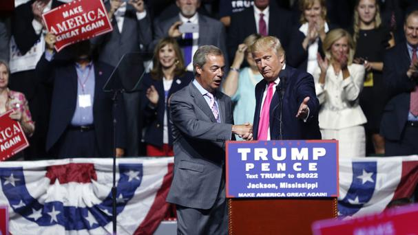 Republican presidential candidate Donald Trump, right, welcomes Nigel Farage at a campaign rally in Jackson, Mississippi (AP)