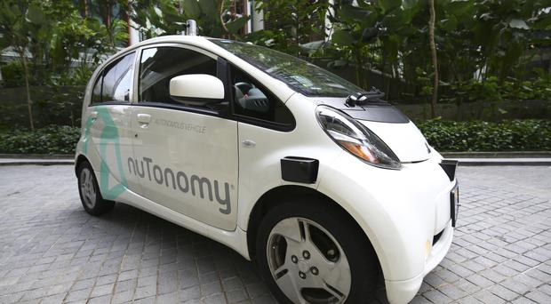 An autonomous vehicle is parked for a test drive in Singapore, where the world's first self-driving taxis, operated by nuTonomy, have been launched (AP Photo/Yong Teck Lim)
