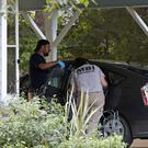 Mississippi Bureau of Investigation agents inspect a car at the home of murdered nuns (AP)