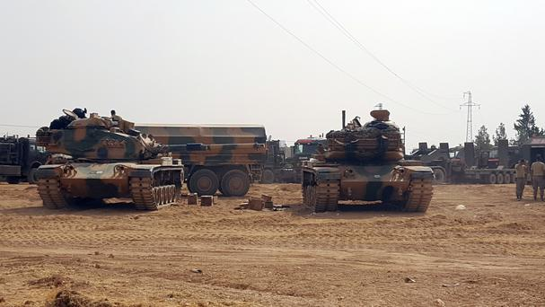 Turkey sent tanks across the Syrian border this week to help Syrian rebels retake a key Islamic State-held town (AP)