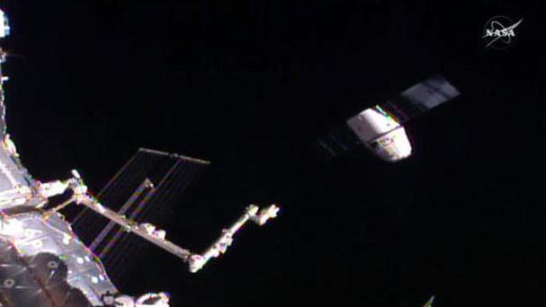 In this frame-grab taken from Nasa Television, a SpaceX Dragon capsule, right, separates from a robotic arm of the ISS (Nasa via AP)