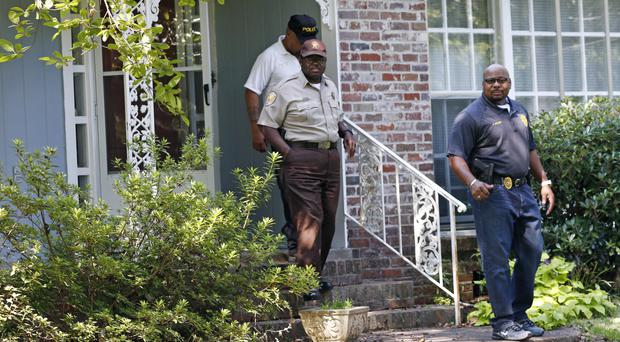 Police at the Durant home of the two nuns (AP)