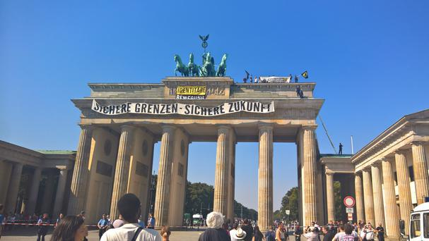 The protest was staged on top of Berlin's Brandenburg Gate (AP)