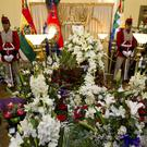 An honour guard stands vigil over the coffin of Bolivia's deputy interior minister Rodolfo Illanes, at the government palace in La Paz (AP)