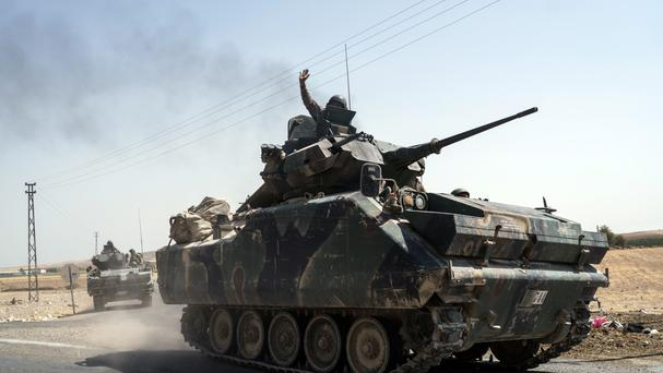 Turkish troops head to the Syrian border, in Karkamis, Turkey (AP)