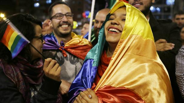 Celebrations in Bogota as the peace deal is announced in Havana, Cuba (AP)