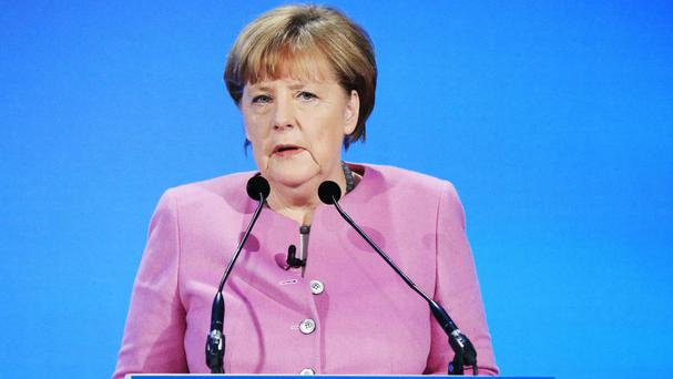 Angela Merkel criticised EU partners who refuse to give Muslims refugee protection