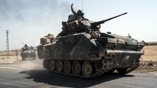 Turkey sent tanks to help Syrian rebels retake the key IS-held town of Jarablus and to contain the expansion of Syria's Kurds (AP Photo/Halit Onur Sandal)