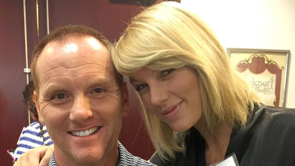 Taylor Swift poses for a photo with Bryan Merville in a courthouse waiting area in Nashville (Bryan Merville/AP)
