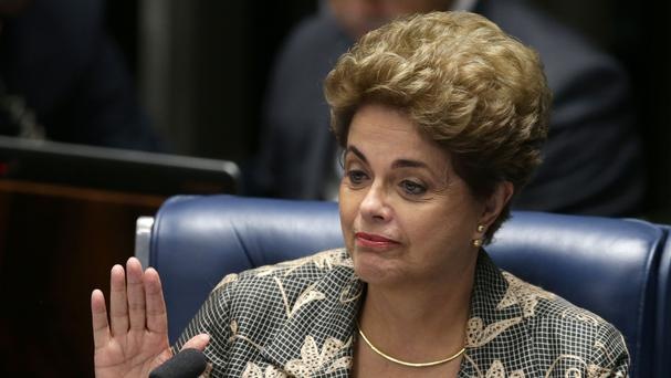 Suspended Brazilian president Dilma Rousseff waves goodbye after her impeachment trial at the Senate in Brasilia (AP)